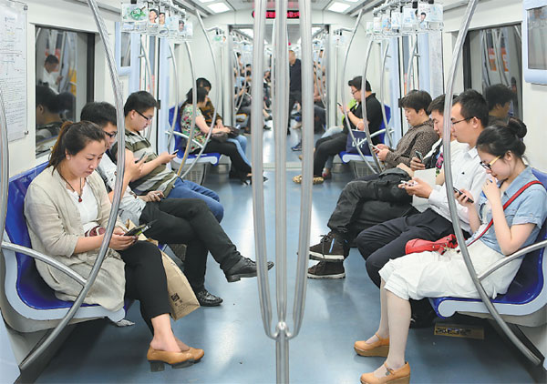 Chinese passengers using smartphones